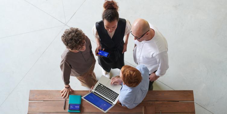 group-of-people-standing-indoors-3184324.jpg